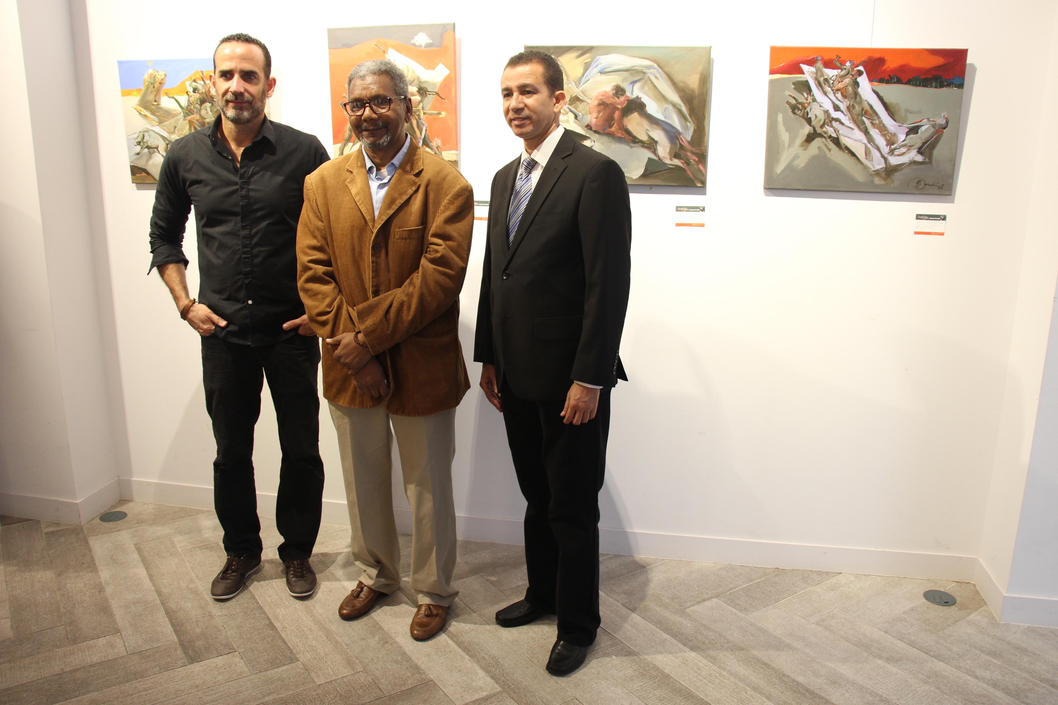 José Pelletier, Gabino Rosario y Dustin Muñoz, artistas visuales que forman parte de Nuestra expo, tercera versión, durante la inauguración en Lugo, España